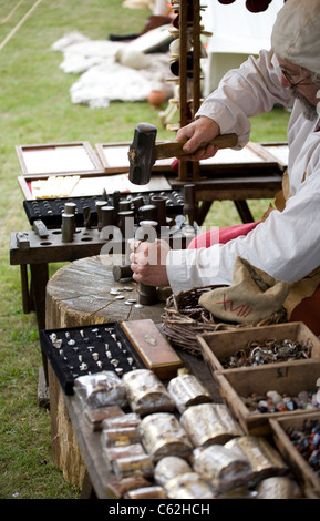 Coin Maker at the Medieval Festival in Verdin Park, Northwich August 13th & 14th, with Living History Camps, Cheshire, - Stock Photo