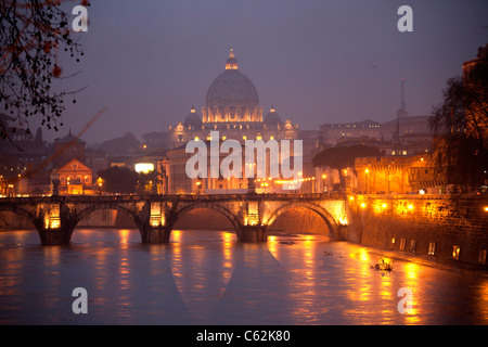 The river Tiber with Bridge of Angels and the illuminated St. Peter's Basilica at the rainy blue hour, Rome, Italy, - Stock Photo