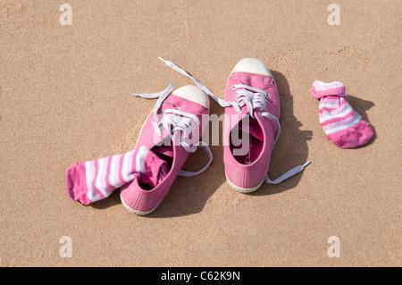 pink pumps on beach - Stock Photo