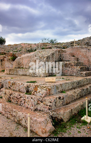 The 'Bema' or 'Vema' of Pnyx, where popular assemblies were taking place in Ancient Athens, Greece. - Stock Photo