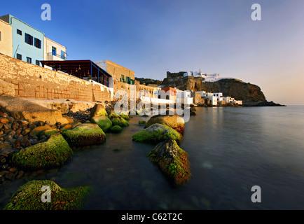 Small part of Mandraki village, the 'capital' of Nisyros island,Greece. In the background the Panagia Spiliani monastery - Stock Photo