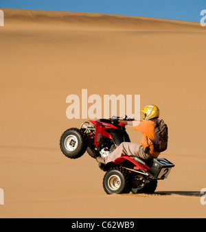 Quad biking on the dunes outside Swakopmund. Swakopmund, Namibia. - Stock Photo