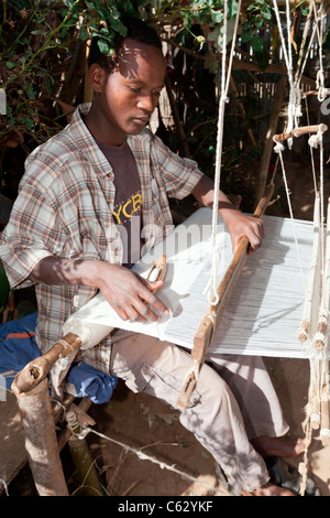 A Dorze tribesman weaving cotton at the village of Chencha near Arba Minch in the Omo Valley, Southern Ethiopia, - Stock Photo