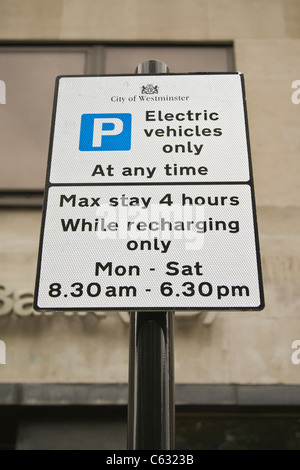 Sign for electric vehicles charging point and parking in London, UK - Stock Photo