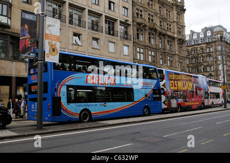 Lothian buses queue on Princes Street Edinburgh Scotland UK - Stock Photo