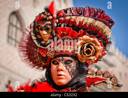Close up of woman with mask and hat during Venice Carnival, Veneto, Italy - Stock Photo