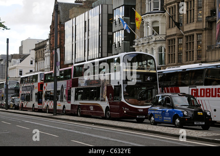 Lothian buses queue on Princes Street Edinburgh Scotland UK - Stock Photo