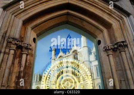 The Corpus Christi Clock with Reflection of King's College, Cambridge, England, UK - Stock Photo
