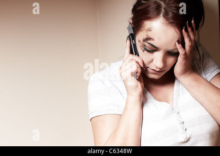 Abused woman calling for help - Stock Photo