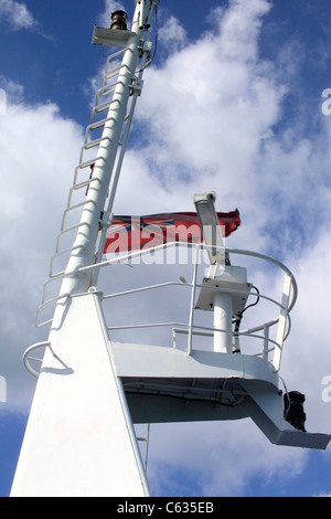 Close-up of  the Communication tower on the Isle of Wight Ferry with satellite receiver and British ensign flag - Stock Photo