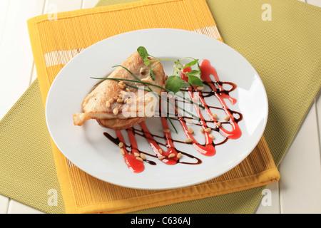 Salmon trout fillet on baked potato - Stock Photo