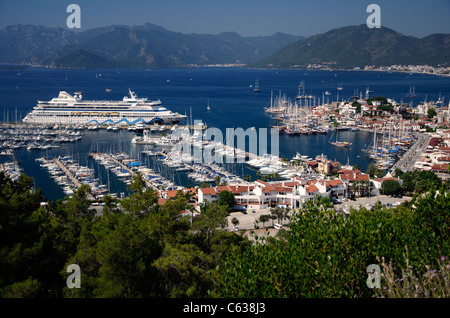 Port of Marmaris, Turkey. Old town with marina and cruise ship AIDA Aura on quay. - Stock Photo