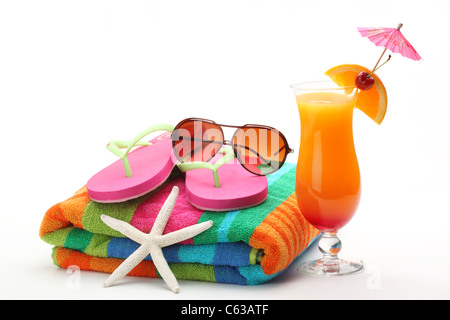 Beach accessories with swimming suit and tequila sunrise cocktail on white background. - Stock Photo