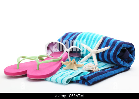 Beach accessories with flip-flops,towel and sunglasses on white background. - Stock Photo