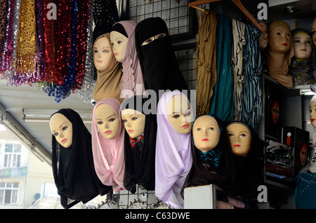 Shop window in the market area of downtown Amman displaying headware, scarves, hijabs, for women. - Stock Photo