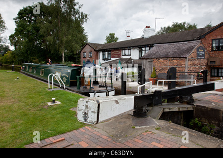 Canal boat leaving the lock at Willey Moor, on the Llangollen Canal near Whitchurch, Shropshire - Stock Photo