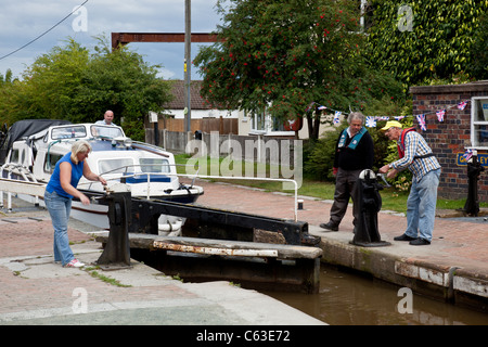 Opening the lock gates at Grindley Brook Staircase locks, Grindley Brook, Cheshire (near Whitchurch in Shropshire) - Stock Photo