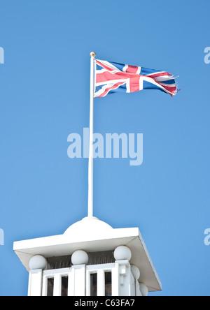 Union Jack flag flying on Brighton Palace Pier - Stock Photo