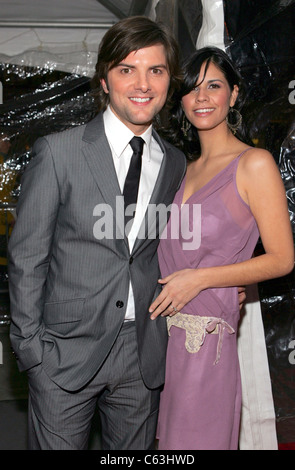 Adam Scott and guest at the premiere of THE AVIATOR at the Ziegfeld Theatre, NY, December 14, 2004. (photo: gbinuya/Everett - Stock Photo