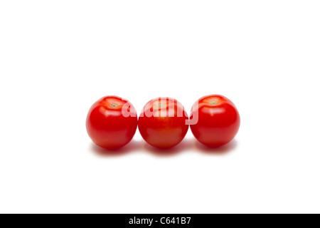 Three ripe cherry tomatoes - Stock Photo