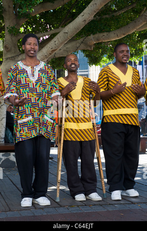 Chorus singer on crutches performing at V&A Waterfront in Cape Town South Africa - Stock Photo
