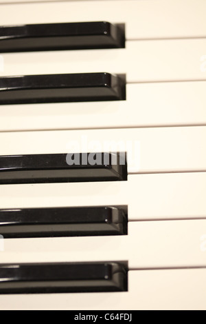 row of black and white piano keys - Stock Photo