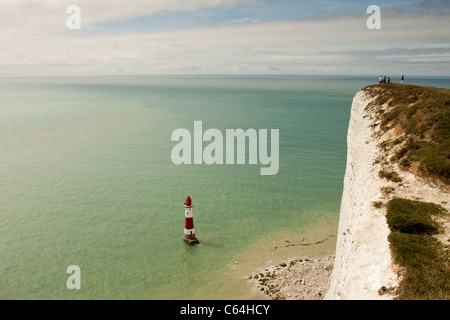 Beachy Head white cliffs and lighthouse, East Sussex, England, UK - Stock Photo