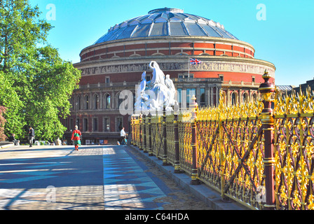 Royal Albert Hall, London, seen from east side of  the Albert Memorial on bright  Spring day with ornate railings - Stock Photo
