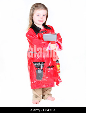 Toddler girl in firefighter costume with axe on white background - Stock Photo