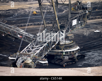 Large excavating machines working at Garzweiler open cast coal mine in Germany - Stock Photo