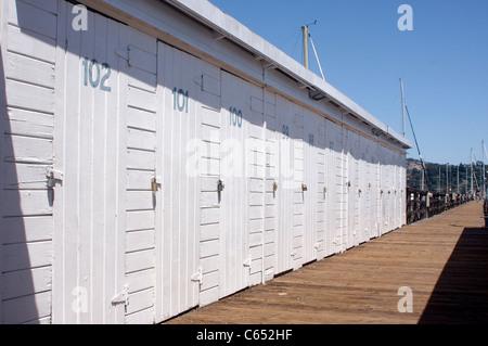 Storage lockers along the deck of a marina in Sausalito, California - Stock Photo