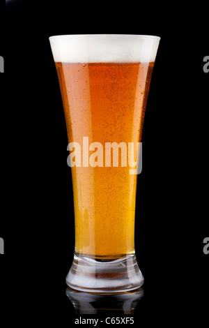 Glass of beer isolated on a black background - Stock Photo