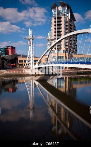The lift bridge aka the Millennium footbridge at Salford Quays, Manchester, England, viewed towards the Lowry Theatre - Stock Photo