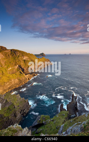 The distant Skellig Islands viewed from cliffs near the village of Portmagee in County Kerry, Ireland - Stock Photo
