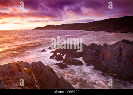 Sunset over the Bristol Channel from Barricane Beach, Woolacombe,looking towards Morte Point, North Devon, England, - Stock Photo