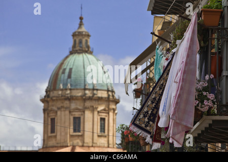Linen, clothes and flowers on balcony and cathedral of Palermo (Duomo) in background. Palermo, Sicily, Italy, Europe, - Stock Photo