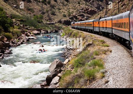 Popular tourist train runs through the 1,000' deep Royal Gorge Route along the Arkansas River, Central Colorado, - Stock Photo