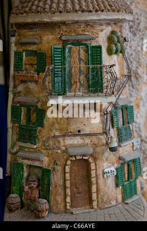 Sculpture on a roof tile representing a building of a poor district of Palermo, Sicily, Italy, Europe, EU. - Stock Photo