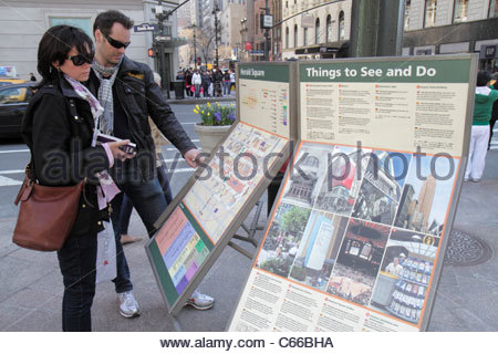 Manhattan New York City NYC NY Midtown 34th Street Broadway Herald Square man woman couple map directions shopping - Stock Photo