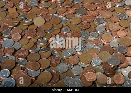 large amount of silver and copper british coins - Stock Photo