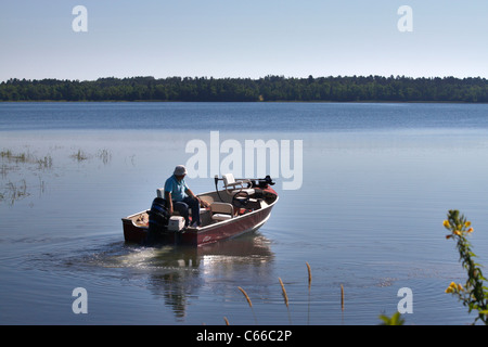 Going out to fish, Lake George Minnesota in morning typical of northern forests - Stock Photo