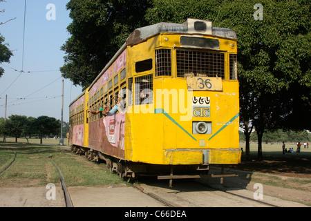 Battered SLC type tram (elephant car) of CTC runs near Victoria Park Kolkata India - Stock Photo