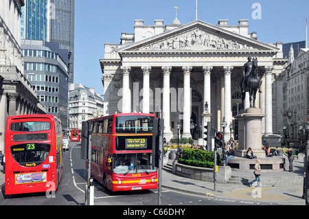 London public transport buses in Threadneedle Street in Square Mile of City of London with The Royal Exchange building - Stock Photo