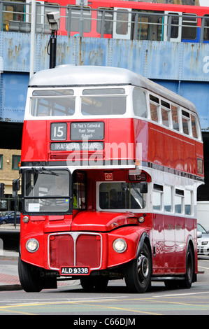 Front view of London Transport public transport red double decker classic historical Routemaster bus & driver in - Stock Photo