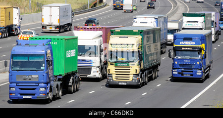Transport lorry truck four lanes section of M25 motorway close up vehicles overtaking slower hgv lorries & trucks - Stock Photo