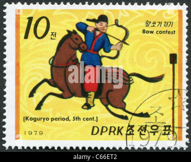 NORTH KOREA - 1979: A stamp printed in North Korea, shows an archer on horseback from Goguryeo - Stock Photo