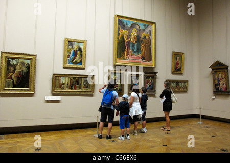 People admiring works of art in the Louvre Museum in Paris France - Stock Photo