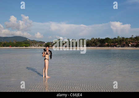 Model posing on a tropical beach - Stock Photo