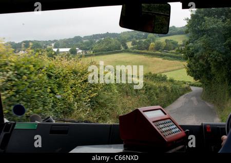 View from Interior looking forward on a mini bus going through a country lane in Devon - Stock Photo