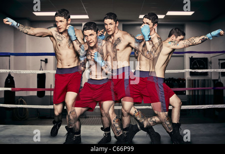 Multiple exposure of boxer punching - Stock Photo